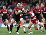 Saracens Will Fraser hands off Gloucester's Rob Cook on December 2, 2012