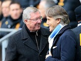 Manachester United manager Alex Ferguson and Manchester City Roberto Mancini shakes hands before kick off on December 9, 2012