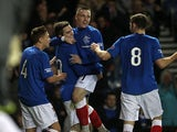 Rangers' Andy Little is congratulated by team mates after scoring his team's second goal on December 8, 2012