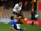 Chesterfield's Sam Hird slides in on Port Vale's Ashley Vincent on December 8, 2012