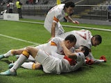 Galatasaray's Aydin Yilmaz is mobbed after scoring on Decemeber 5, 2012