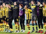 Dortmund squad members celebrate winning Champions League Group D on December 4, 2012