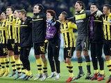 Dortmund squad members celebrate winning Champions League Group D on December 4, 2012