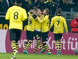 Borussia Dortmund's Marco Reus is congratulated by team mates after scoring the opener on December 8, 2012