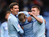 Coventry City's Carl Baker is congratulated by team mates after scoring his second on December 8, 2012