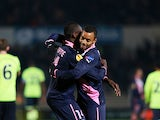 Bordeaux's Cheick Diabate is congratulated by team mate David Bellion after scoring the opener on December 6, 2012