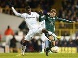 Tottenham Hotspur's Emmanuel Adebayor and Panathinaikos' Charis Mavrias battle for the ball on December 6, 2012