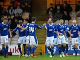 Chesterfield's James O'Shea is congratulated by team mates after scoring the opener on December 8, 2012