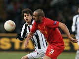 Liverpool's Jose Enrique and Udinese's Diego Fabbrini battle for the ball on December 6, 2012
