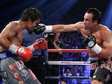 Juan Manuel Marquez lands a punch straight in the face of Manny Pacquiao on December 9, 2012