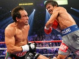 Juan Manuel Marquez is knocked down by Manny Pacquiao on December 9, 2012