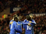 Chelsea players congratulate Juan Mata after a goal on December 8, 2012