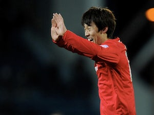 Cardiff's Kim Bo-Kyung celebrates his goal on December 7, 2012