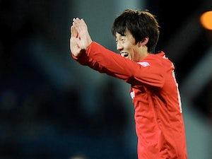 Cardiff's Kim Bo-Kyung celebrates his goal on December 7, 2012
