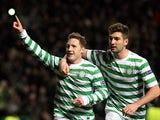 Celtic's Kris Commons celebrates his winning penalty on December 5, 2012