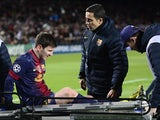 Barca star Lionel Messi is stretchered off injured on December 5, 2012