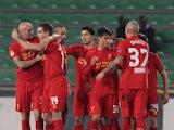 Liverpool team mates congratulate Jordan Henderson after scoring the opener on December 6, 2012