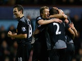 Glen Johnson is congratulated by team mates after scoring the opener on December 9, 2012