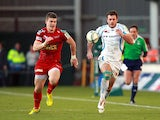 Exeter Chiefs' Luke Arscott and Scarlets' Scott Williams chase down a through ball on December 8, 2012