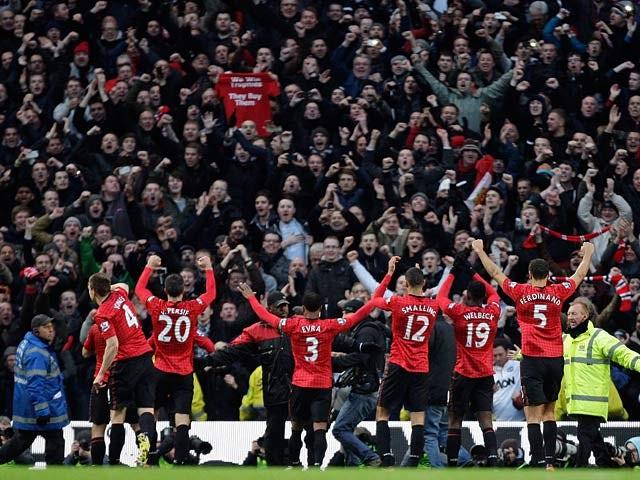 Man Utd fans light up town hall red