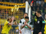 Borussia Dortmund's Marcel Schmelzer is shown a red card during the match against Wolfsburg on December 8, 2012