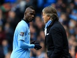 Mario Balotelli looks towards manager Roberto Mancini as he is substituted in the Manchester derby on December 9, 2012