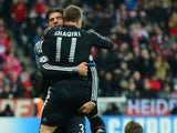 Mario Gomez celebrates his goal with Xerdan Shaqiri against BATE on December 5, 2012