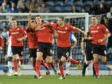 Cardiff skipper Mark Hudson celebrates after opening the scoring on December 7, 2012