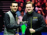 Shaun Murphy and Mark Selby pose with the trophy before the UK Championship final on December 9, 2012