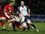Worcester Warriors' Matt Kvesic is tackled by Perpignan's James Hook on December 6, 2012