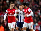 Mikel Arteta is congratulated by Jack Wilshere after his penalty on December 8, 2012