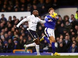 Nikica Jelavic and William Gallas battle for the ball on December 9, 2012