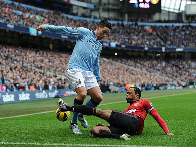 Patrice Evra and Samir Evra battle for the ball on December 9, 2012