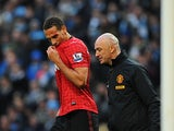 Rio Ferdinand receives medical treatment to his cut head on December 9, 2012