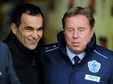 Managers Roberto Martinez and Harry Redknapp before the game between Wigan and QPR on December 8, 2012