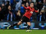 Robin Van Persie celebrates scoring the winner against Manchester City on December 9, 2012