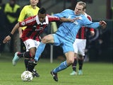 Milan forward Robinho shields the ball versus Zenit on December 4, 2012