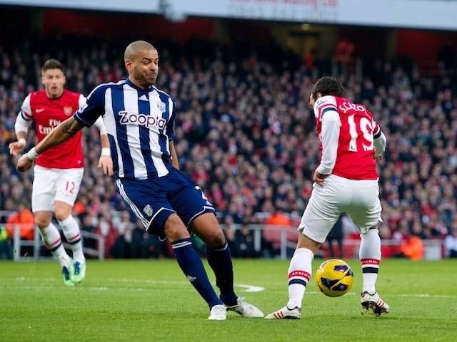 Arsenal midfielder Santi Cazorla wins a controversial penalty against West Brom on December 8, 2012