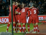 Southampton players mob Jason Puncheon after his strike against Reading on December 8, 2012