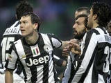 Juventus' Stephan Lichtsteiner is congratulated by team-mates after scoring the winning goal against Palermo on December 9, 2012