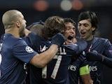 PSG players celebrate their goal against Porto on December 4, 2012