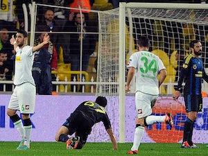 Borussia Moenchengladbach's Tolga Cigerci celebrates moments after netting a goal against Fenerbahce on December 6, 2012