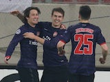 Arsenal's Tomas Rosicky is congratulated after scoring on December 4, 2012