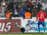 Viktoria Plzen's Vaclav Prochazka strikes the ball past Atletico Madrid goalkeeper Sergio Asenjo on December 6, 2012