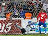 Viktoria Plzen's Vaclav Prochazka strikes the ball past Atletico Madrid goalkeeper Sergio Asenjo on December 6, 2012