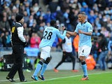 Vincent Kompany is substituted for Kolo Toure after picking up an injury on December 9, 2012