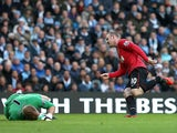 Wayne Rooney slots the ball past Joe Hart to score his second goal on December 9, 2012
