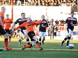 Dundee United's Willo Flood scores his team's third goal against rivals Dundee on December 9, 2012