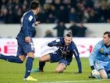 Paris Saint Germain's Ezequiel Lavezzi is congratulated by Zlatan Ibrahimovic after scoring his team's second goal on December 8, 2012