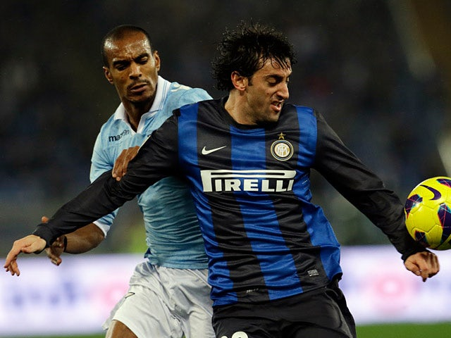 Lazio's Abdoulay Konko and Inter Milan's Diego Milito battle for the ball on December 15, 2012